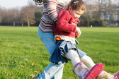 Older sister carrying — Stock Photo