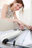 Businesswoman flicking clients files — Stock Photo