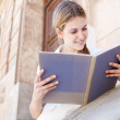 Girl reading her notebook — Stock Photo #47005143