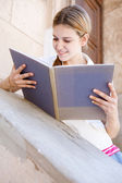 Girl reading her notebook — Stock Photo