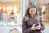 Woman using  smartphone — Stock Photo