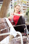 Young sports woman sitting — Stock Photo
