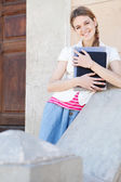 Girl holding her notebooks — Stock Photo