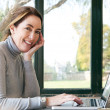 Woman typing on  laptop — Stock Photo #47344975