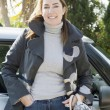 Woman leaning on her car — Stock Photo #47345561