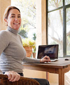 Woman using her laptop — Stock Photo