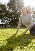 Woman sitting on green grass — Stock Photo