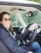 Woman sitting on  driver seat — Stock Photo