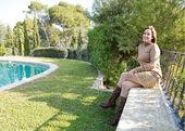 Woman in a home garden — Stock Photo