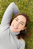 Laying down on green grass — Stock Photo