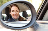 Woman sitting on car, — Stock Photo
