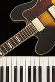 Electric guitar and  keyboard — Stock Photo