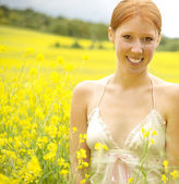 Girl relaxing on  flowers field — Stock Photo