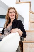 Businesswoman sitting down on her home office — Stock Photo