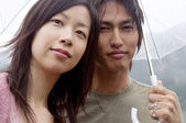 Young asian japanese couple visiting a natural lake — Stock Photo