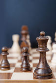 Queen chess dark wooden piece — Stock Photo