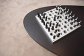 Chess game on a dark wooden table — Stockfoto