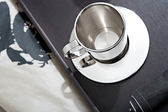 Silver coffee cup and servillette — Stock Photo