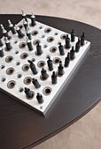 Chess game on a dark wooden table — Stock Photo
