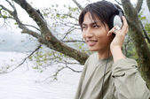 Man listening to music with his headphones — Stock Photo