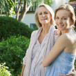 Daughter and mother in a home garden — Stock Photo #48311499