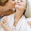 Daughter kissing her mature mother — Stock Photo #48311705