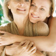Daughter and her mature mother hugging — Stock Photo #48311735