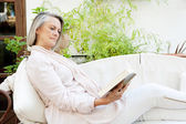 Woman lounging and relaxing at home — Foto Stock