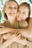Daughter and her mature mother hugging — Stock Photo