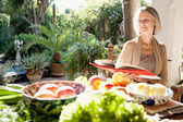 Woman sitting in her home garden — Stock Photo