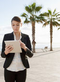 Business woman standing near the sea — Stock Photo