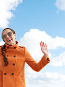 Woman waving hello or goodbye — Foto Stock
