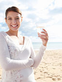 Woman holding glass of pure mineral water — Stock Photo