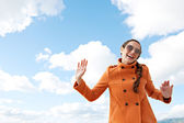 Woman singing against a bright blue sky — Stock Photo