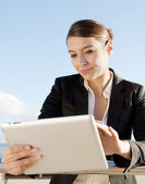 Business woman holding and using a digital tablet — Stock Photo