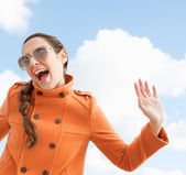 Woman shouting and holding her arms in the air — Stock Photo
