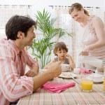Family of three having breakfast — Stock Photo #48322217