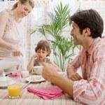 Family of three having breakfast — Stock Photo #48322447