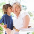 Grand child boy kissing grandmother — Stock Photo #48322649