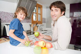 Dad with his son together in a home kitchen — Stockfoto