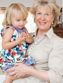 Grand mother carrying her grand daughter — Stock Photo