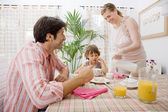Family of three having breakfast — Stock Photo
