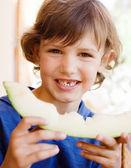 Kid boy holding melon — Stock Photo