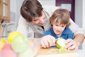 Dad with his son together in a home kitchen — Stock Photo