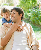Son hugging his father — Stock Photo