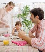 Family of three having breakfast — Stock Photo