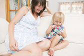 Pregnant mother and daughter relaxing — Stock Photo