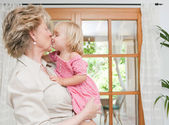 Grand mother kissing grand daughter — Stock Photo