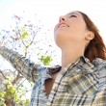 Woman enjoying the sun — Stock Photo #48446239