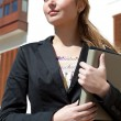 Businesswoman holding a digital tablet — Stock Photo